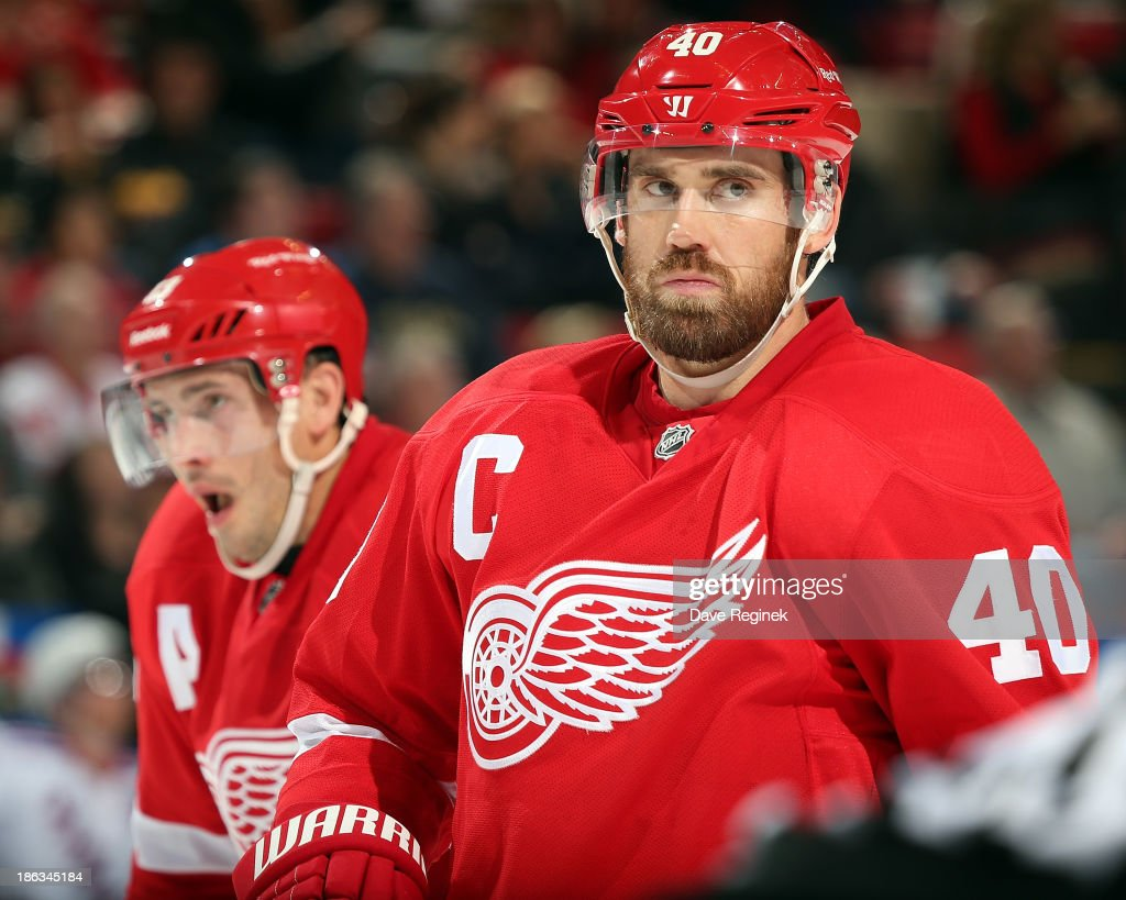 Henrik Zetterberg #40 and Pavel Datsyuk #13 of the Detroit Red Wings gets set for the face-off during an NHL game against the New York Rangers at Joe Louis Arena on October 26, 2013 in Detroit, Michigan. The Rangers win in O