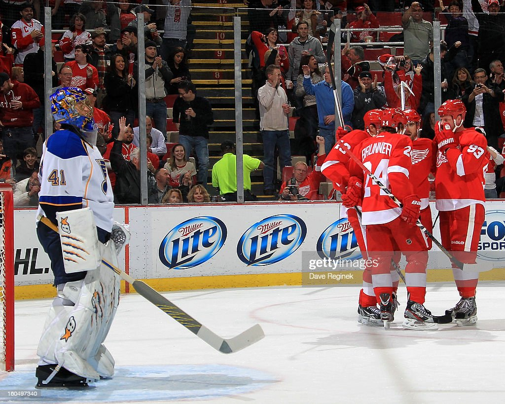 Henrik Zetterberg #40, Damien Brunner #24, Pavel Datsyuk #13 and Johan Franzen #93 of the Detroit Red Wings celebrate after scoring a first period goal while goalie Jaroslav Halak #41 of the St Louis Blues looks up at the score board during a NHL game at Joe Louis Arena on February 1, 2013 in Detroit, Michigan.