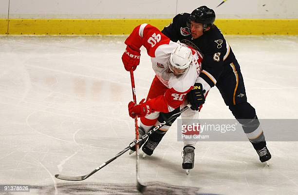 Henrik Zetterberg of Detroit Red Wings battles for the puck with Erik Johnson of St Louis Blues during the 2009 Compuware NHL Premiere Stockholm...