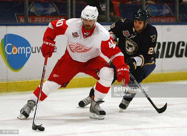 Henrik Zetterberg of Detroit Red Wings battles for the puck with Carlo Colaiacovo of St Louis Blues during the 2009 Compuware NHL Premiere Stockholm...