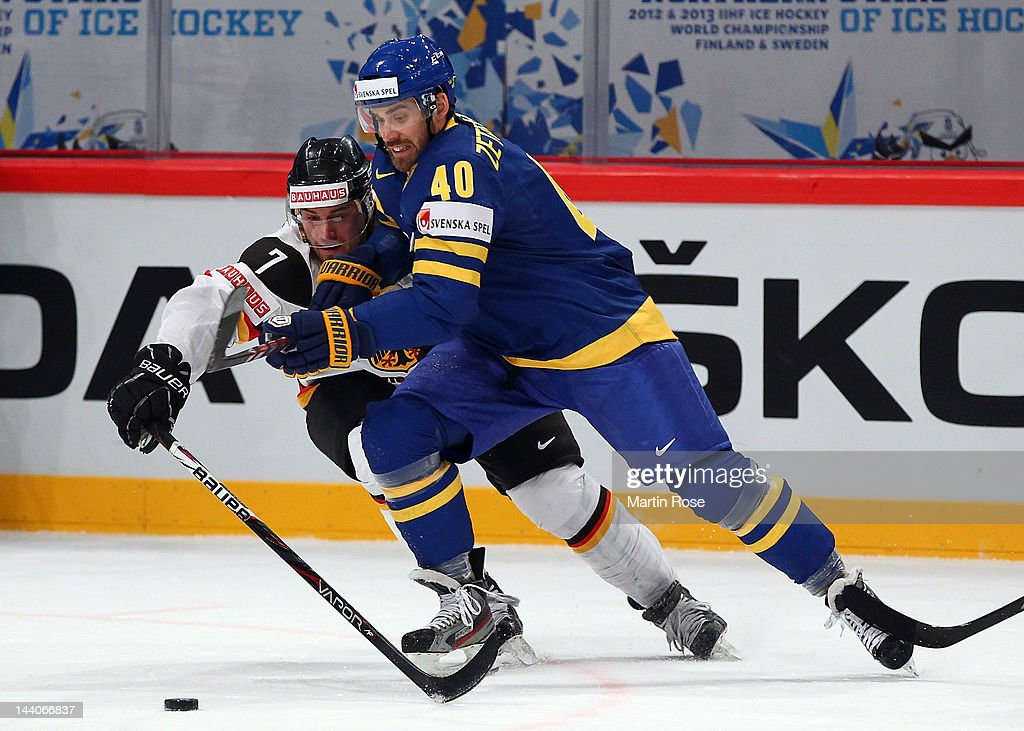 Henrik Zetterberg of Sweden and Niklas Kronwall of Germany battle for the puck during the IIHF World Championship group S match between Sweden and...