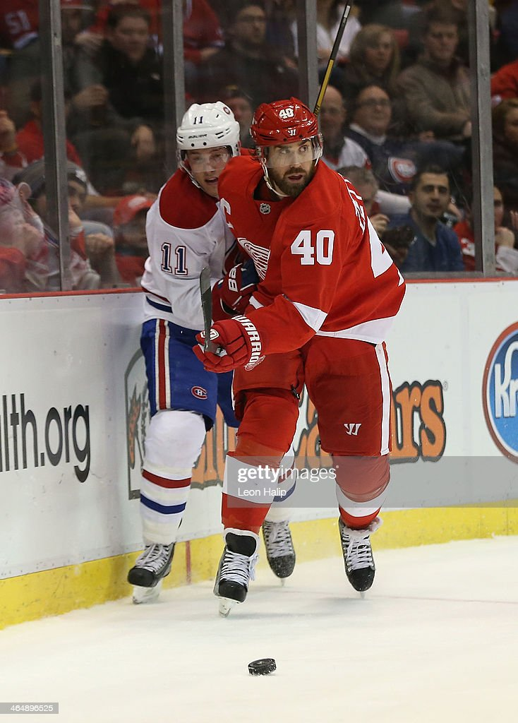 <a gi-track='captionPersonalityLinkClicked' href=/galleries/search?phrase=Henrik+Zetterberg&family=editorial&specificpeople=201520 ng-click='$event.stopPropagation()'>Henrik Zetterberg</a> #40 of the Detroit Red Wings and <a gi-track='captionPersonalityLinkClicked' href=/galleries/search?phrase=Brendan+Gallagher&family=editorial&specificpeople=3704208 ng-click='$event.stopPropagation()'>Brendan Gallagher</a> #11 of the Montreal Canadiens battle for puck control during the third period of the game at Joe Louis Arena on January 24, 2014 in Detroit, Michigan. The Wings defeated the Canadiens 4-1.