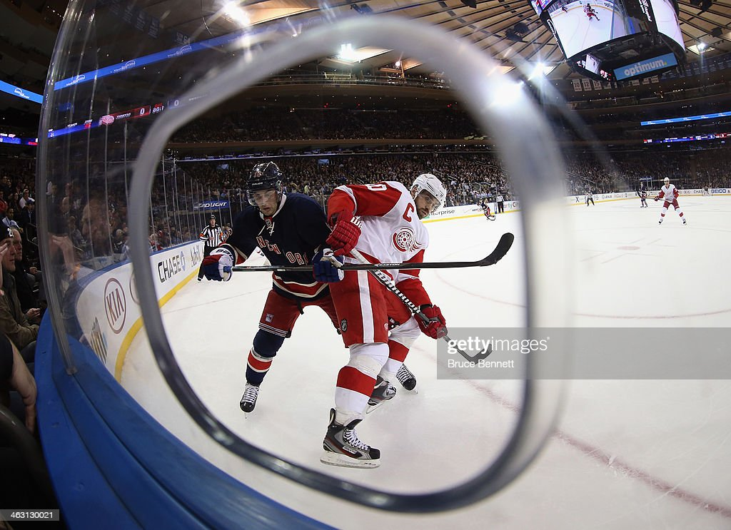 <a gi-track='captionPersonalityLinkClicked' href=/galleries/search?phrase=Henrik+Zetterberg&family=editorial&specificpeople=201520 ng-click='$event.stopPropagation()'>Henrik Zetterberg</a> #40 of the Detroit Red Wings and <a gi-track='captionPersonalityLinkClicked' href=/galleries/search?phrase=Derick+Brassard&family=editorial&specificpeople=540468 ng-click='$event.stopPropagation()'>Derick Brassard</a> #16 of the New York Rangers battle for position at Madison Square Garden on January 16, 2014 in New York City. The Rangers shutout the Red Wings 1-0.