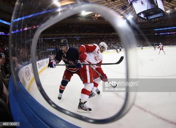Henrik Zetterberg of the Detroit Red Wings and Derick Brassard of the New York Rangers battle for position at Madison Square Garden on January 16...