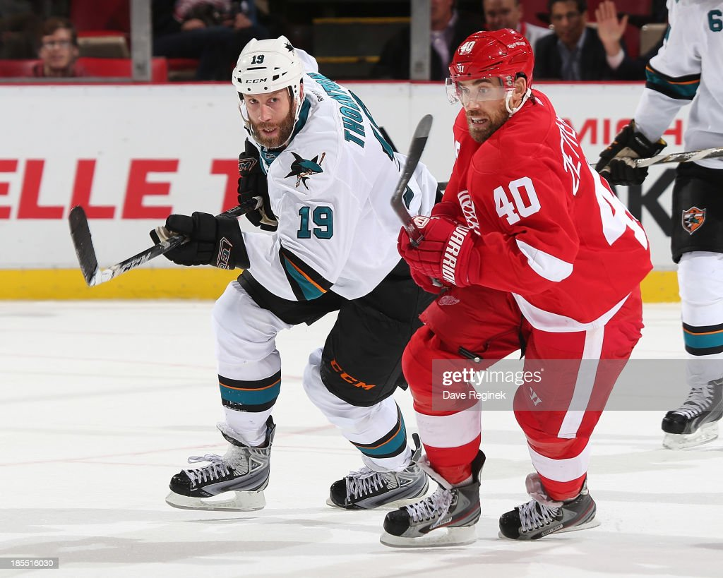<a gi-track='captionPersonalityLinkClicked' href=/galleries/search?phrase=Henrik+Zetterberg&family=editorial&specificpeople=201520 ng-click='$event.stopPropagation()'>Henrik Zetterberg</a> #40 of the Detroit Red Wings and <a gi-track='captionPersonalityLinkClicked' href=/galleries/search?phrase=Joe+Thornton&family=editorial&specificpeople=201829 ng-click='$event.stopPropagation()'>Joe Thornton</a> #19 of the San Jose Sharks turns up ice during an NHL game at Joe Louis Arena on October 21, 2013 in Detroit, Michigan. San Jose Sharks win in a shoot-out 1-0