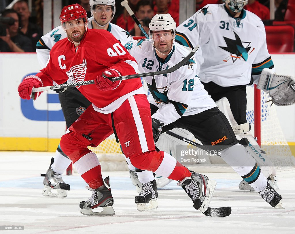 <a gi-track='captionPersonalityLinkClicked' href=/galleries/search?phrase=Henrik+Zetterberg&family=editorial&specificpeople=201520 ng-click='$event.stopPropagation()'>Henrik Zetterberg</a> #40 of the Detroit Red Wings and <a gi-track='captionPersonalityLinkClicked' href=/galleries/search?phrase=Patrick+Marleau&family=editorial&specificpeople=203165 ng-click='$event.stopPropagation()'>Patrick Marleau</a> #12 of the San Jose Sharks battle for position in front of the net during an NHL game at Joe Louis Arena on October 21, 2013 in Detroit, Michigan. San Jose Sharks win in a shoot-out 1-0