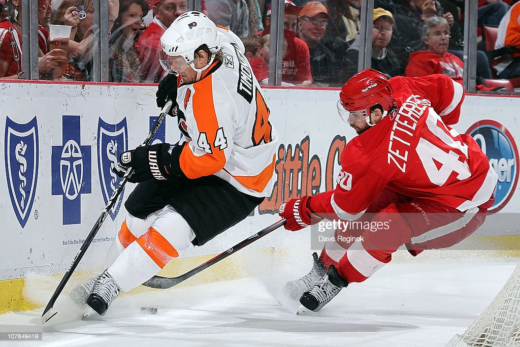 Henrik Zetterberg #40 of the Detroit Red Wings battles for the puck with Kimmo Timonen #44 of the Philadelphia Flyers during an NHL game at Joe Louis Arena on January 2, 2011 in Detroit, Michigan. FLyers beat Wings 3-2