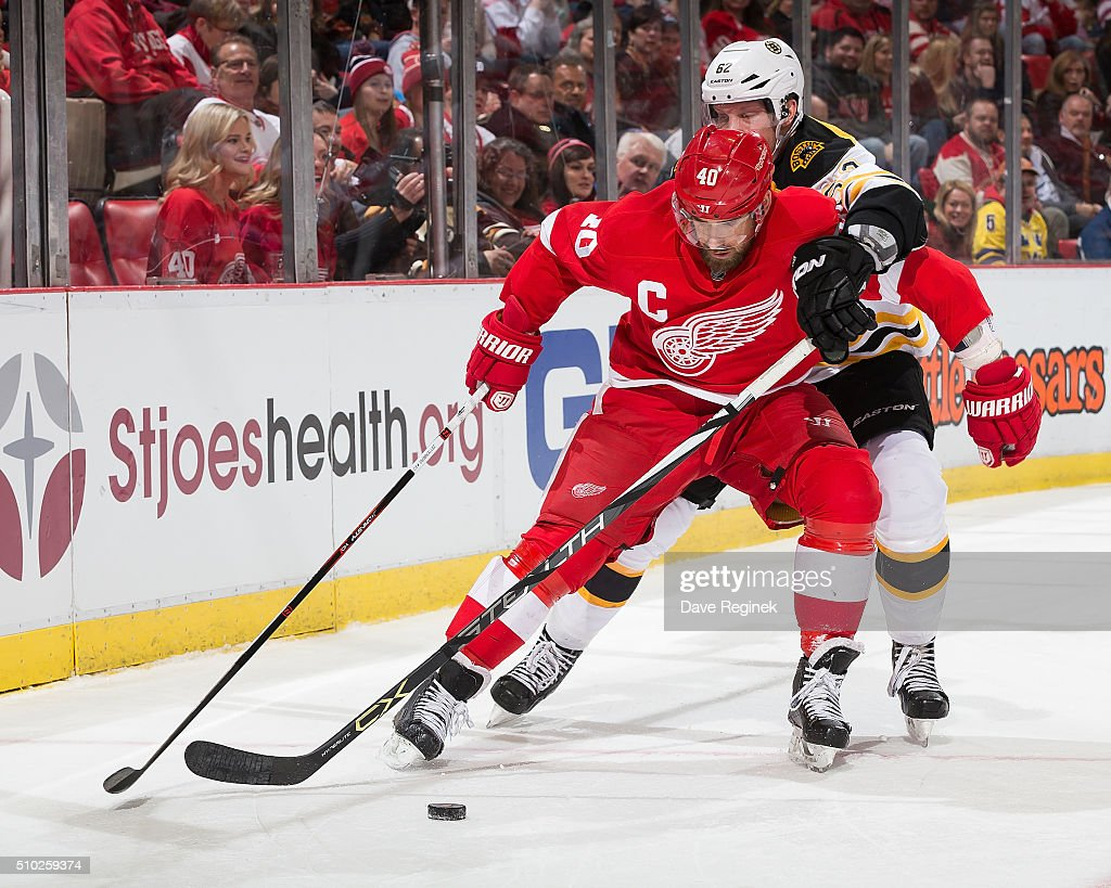 <a gi-track='captionPersonalityLinkClicked' href=/galleries/search?phrase=Henrik+Zetterberg&family=editorial&specificpeople=201520 ng-click='$event.stopPropagation()'>Henrik Zetterberg</a> #40 of the Detroit Red Wings battles for the puck with <a gi-track='captionPersonalityLinkClicked' href=/galleries/search?phrase=Zach+Trotman&family=editorial&specificpeople=11380140 ng-click='$event.stopPropagation()'>Zach Trotman</a> #62 of the Boston Bruins during an NHL game at Joe Louis Arena on February 14, 2016 in Detroit, Michigan.