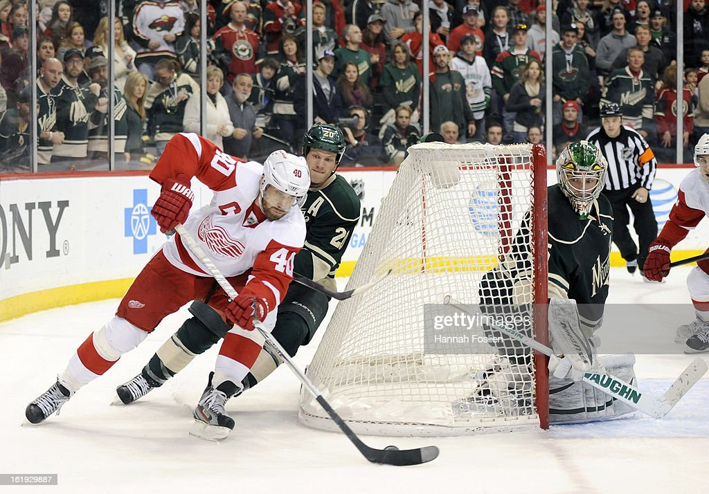 <a gi-track='captionPersonalityLinkClicked' href=/galleries/search?phrase=Henrik+Zetterberg&family=editorial&specificpeople=201520 ng-click='$event.stopPropagation()'>Henrik Zetterberg</a> #40 of the Detroit Red Wings brings the puck around the net against <a gi-track='captionPersonalityLinkClicked' href=/galleries/search?phrase=Ryan+Suter&family=editorial&specificpeople=583306 ng-click='$event.stopPropagation()'>Ryan Suter</a> #20 of the Minnesota Wild as Darcy Kuemper #35 defends the net during the third period of the game on February 17, 2013 at Xcel Energy Center in St Paul, Minnesota. The Wild defeated the Red Wings 3-2.