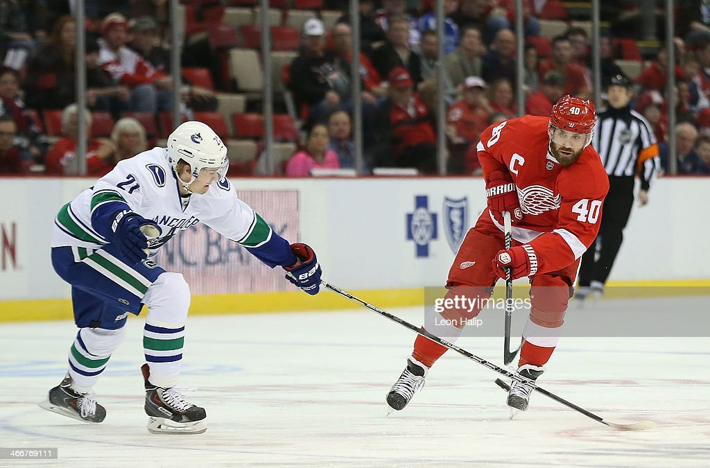 <a gi-track='captionPersonalityLinkClicked' href=/galleries/search?phrase=Henrik+Zetterberg&family=editorial&specificpeople=201520 ng-click='$event.stopPropagation()'>Henrik Zetterberg</a> #40 of the Detroit Red Wings carries the puck across the blue line as <a gi-track='captionPersonalityLinkClicked' href=/galleries/search?phrase=Zac+Dalpe&family=editorial&specificpeople=5370972 ng-click='$event.stopPropagation()'>Zac Dalpe</a> #21 of the Vancouver Canucks defends during the first period of the game at Joe Louis Arena on February 3, 2014 in Detroit, Michigan. The Red Wings defeated the Canucks 2-0.