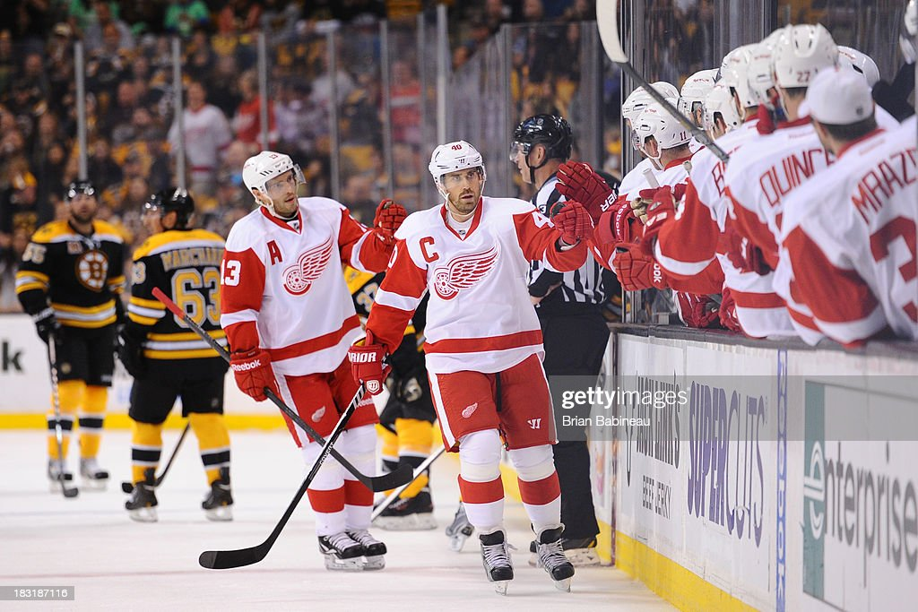 <a gi-track='captionPersonalityLinkClicked' href=/galleries/search?phrase=Henrik+Zetterberg&family=editorial&specificpeople=201520 ng-click='$event.stopPropagation()'>Henrik Zetterberg</a> #40 of the Detroit Red Wings celebrates a goal against the Boston Bruins at the TD Garden on October 5, 2013 in Boston, Massachusetts.