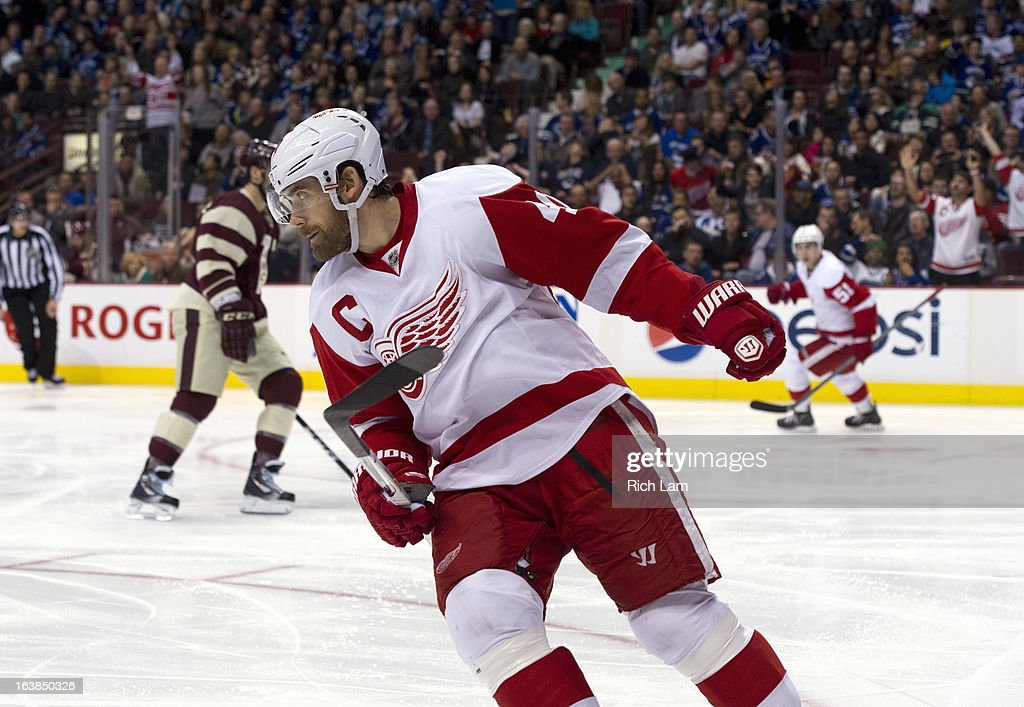 <a gi-track='captionPersonalityLinkClicked' href=/galleries/search?phrase=Henrik+Zetterberg&family=editorial&specificpeople=201520 ng-click='$event.stopPropagation()'>Henrik Zetterberg</a> #40 of the Detroit Red Wings celebrates after scoring a goalie against the Vancouver Canucks during the third period of NHL action on March 16, 2013 at Rogers Arena in Vancouver, British Columbia, Canada.