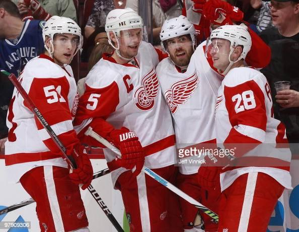Henrik Zetterberg of the Detroit Red Wings celebrates his overtime winning goal with teammates Valtteri Filppula Nicklas Lidstrom and Brian Rafalski...