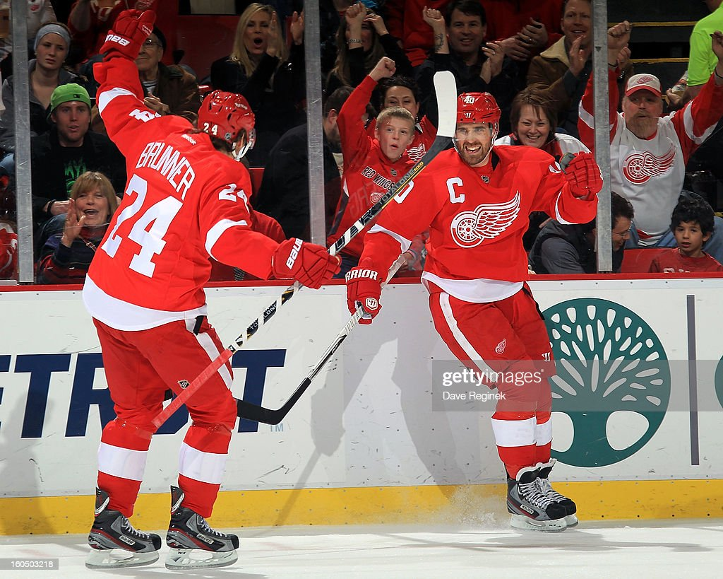 <a gi-track='captionPersonalityLinkClicked' href=/galleries/search?phrase=Henrik+Zetterberg&family=editorial&specificpeople=201520 ng-click='$event.stopPropagation()'>Henrik Zetterberg</a> #40 of the Detroit Red Wings celebrates one of his goals with teammate <a gi-track='captionPersonalityLinkClicked' href=/galleries/search?phrase=Damien+Brunner&family=editorial&specificpeople=6931570 ng-click='$event.stopPropagation()'>Damien Brunner</a> #24 during a NHL game against the St Louis Blues at Joe Louis Arena on February 1, 2013 in Detroit, Michigan. Detroit defeated St Louis 5-3.
