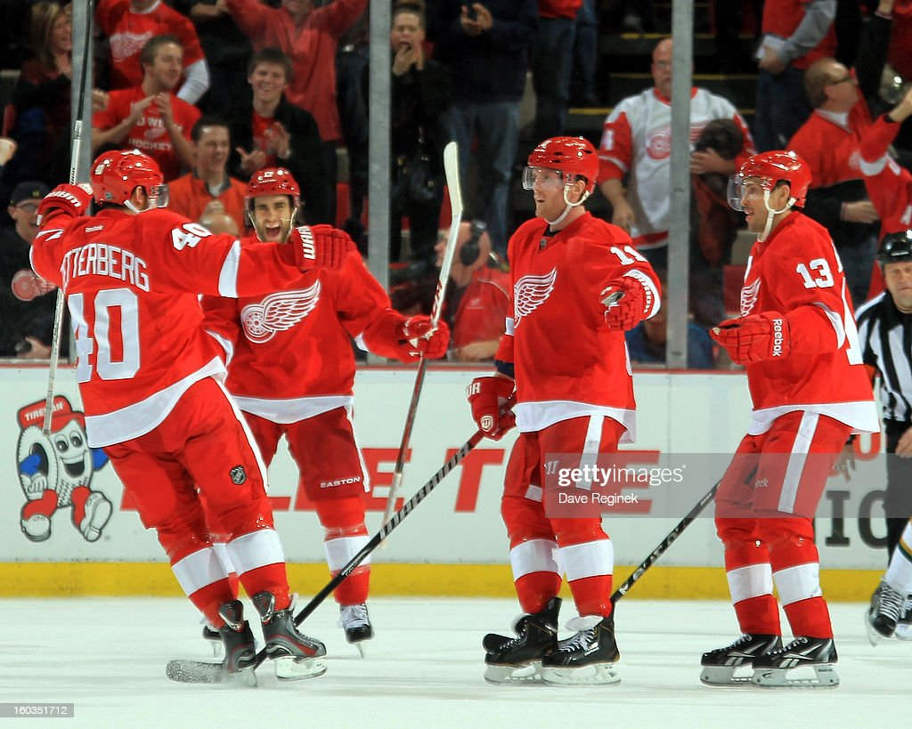 <a gi-track='captionPersonalityLinkClicked' href=/galleries/search?phrase=Henrik+Zetterberg&family=editorial&specificpeople=201520 ng-click='$event.stopPropagation()'>Henrik Zetterberg</a> #40 of the Detroit Red Wings celebrates with teamates <a gi-track='captionPersonalityLinkClicked' href=/galleries/search?phrase=Patrick+Eaves&family=editorial&specificpeople=616319 ng-click='$event.stopPropagation()'>Patrick Eaves</a> #17, <a gi-track='captionPersonalityLinkClicked' href=/galleries/search?phrase=Daniel+Cleary&family=editorial&specificpeople=220490 ng-click='$event.stopPropagation()'>Daniel Cleary</a> #11 and Pavel Datysuk #13 after scoring a power play goal in a NHL game against the Dallas Stars at Joe Louis Arena on January 29, 2013 in Detroit, Michigan.