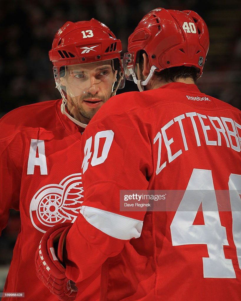 Henrik Zetterberg #40 of the Detroit Red Wings chats with teammate Pavel Datsyuk #13 during an NHL game against the Dallas Stars at Joe Louis Arena on January 22, 2013 in Detroit, Michigan. Dallas won the game 2-1