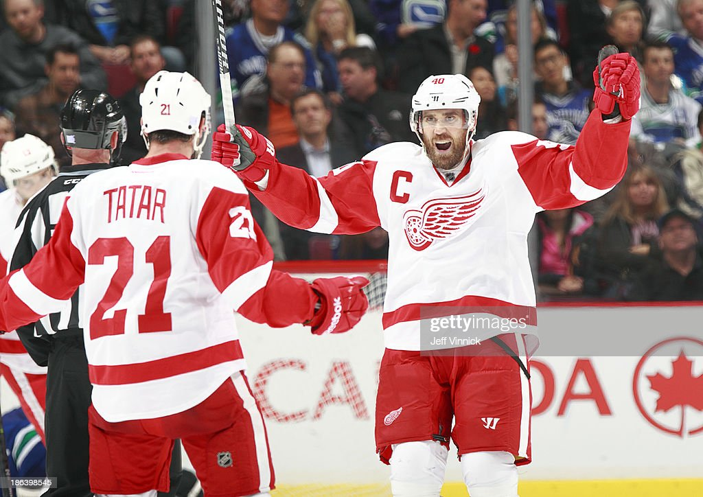 <a gi-track='captionPersonalityLinkClicked' href=/galleries/search?phrase=Henrik+Zetterberg&family=editorial&specificpeople=201520 ng-click='$event.stopPropagation()'>Henrik Zetterberg</a> #40 of the Detroit Red Wings congratulates <a gi-track='captionPersonalityLinkClicked' href=/galleries/search?phrase=Tomas+Tatar&family=editorial&specificpeople=5652303 ng-click='$event.stopPropagation()'>Tomas Tatar</a> #21who scored against the Vancouver Canucks during their NHL game at Rogers Arena on October 30, 2013 in Vancouver, British Columbia, Canada.