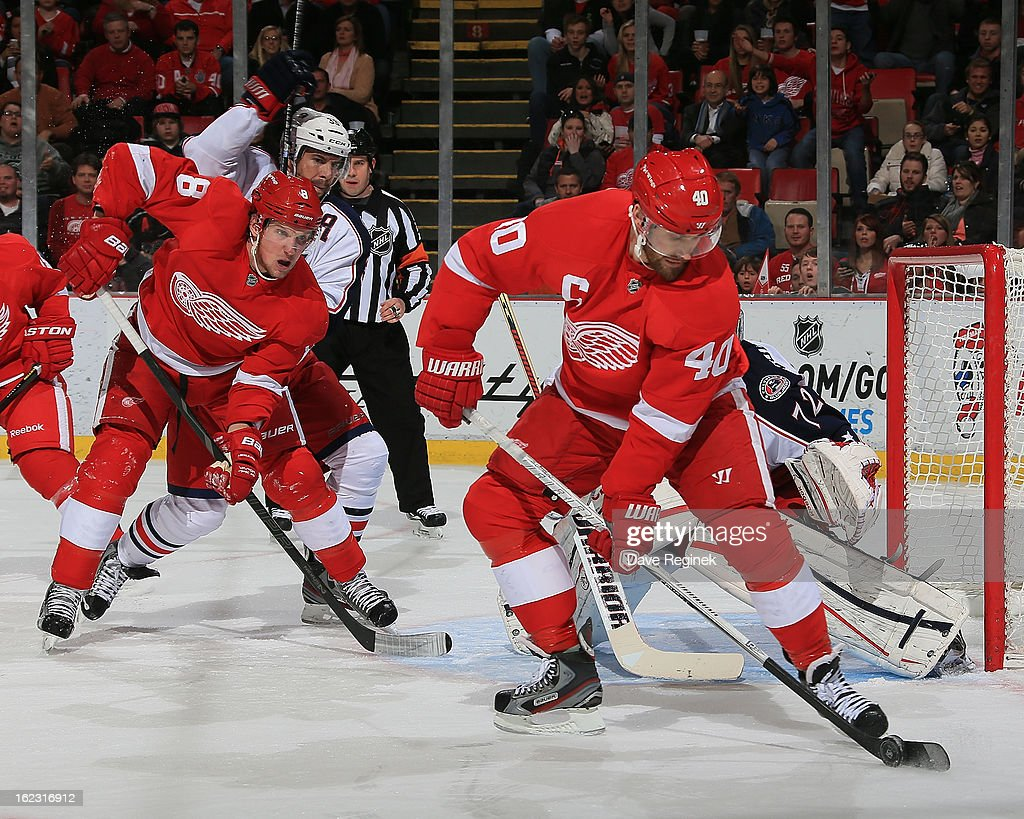 <a gi-track='captionPersonalityLinkClicked' href=/galleries/search?phrase=Henrik+Zetterberg&family=editorial&specificpeople=201520 ng-click='$event.stopPropagation()'>Henrik Zetterberg</a> #40 of the Detroit Red Wings controls the puck as teammate <a gi-track='captionPersonalityLinkClicked' href=/galleries/search?phrase=Justin+Abdelkader&family=editorial&specificpeople=2271858 ng-click='$event.stopPropagation()'>Justin Abdelkader</a> #8 skates in for a pass against the Columbus Blue Jackets during a NHL game at Joe Louis Arena on February 21, 2013 in Detroit, Michigan.