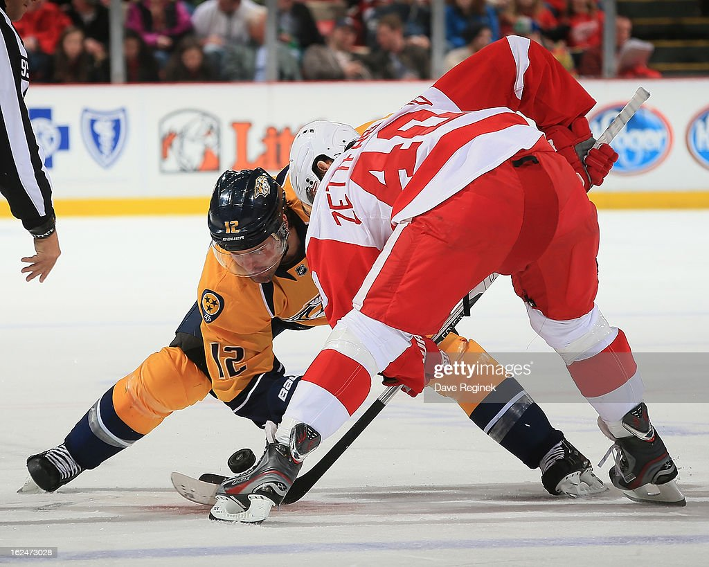<a gi-track='captionPersonalityLinkClicked' href=/galleries/search?phrase=Henrik+Zetterberg&family=editorial&specificpeople=201520 ng-click='$event.stopPropagation()'>Henrik Zetterberg</a> #40 of the Detroit Red Wings faces off against <a gi-track='captionPersonalityLinkClicked' href=/galleries/search?phrase=Mike+Fisher+-+Ice+Hockey+Player&family=editorial&specificpeople=204732 ng-click='$event.stopPropagation()'>Mike Fisher</a> #12 of the Nashville Predators during a NHL game at Joe Louis Arena on February 23, 2013 in Detroit, Michigan. The Wings won 4-0
