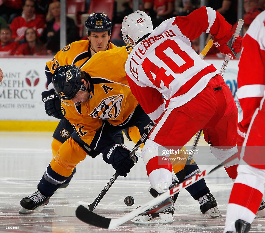 Henrik Zetterberg #40 of the Detroit Red Wings faces off with Mike Fisher #12 of the Nashville Predators at Joe Louis Arena on February 23, 2013 in Detroit, Michigan. Detroit won the game 4-0.