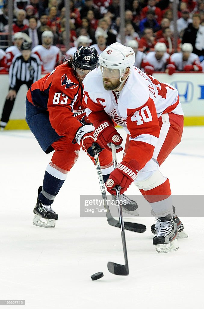 <a gi-track='captionPersonalityLinkClicked' href=/galleries/search?phrase=Henrik+Zetterberg&family=editorial&specificpeople=201520 ng-click='$event.stopPropagation()'>Henrik Zetterberg</a> #40 of the Detroit Red Wings handles the puck in the second period against <a gi-track='captionPersonalityLinkClicked' href=/galleries/search?phrase=Jay+Beagle&family=editorial&specificpeople=4671535 ng-click='$event.stopPropagation()'>Jay Beagle</a> #83 of the Washington Capitals at Verizon Center on February 2, 2014 in Washington, DC.
