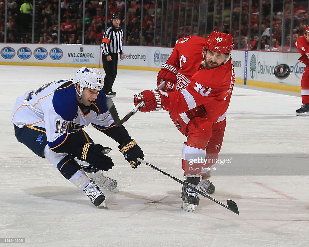 <a gi-track='captionPersonalityLinkClicked' href=/galleries/search?phrase=Henrik+Zetterberg&family=editorial&specificpeople=201520 ng-click='$event.stopPropagation()'>Henrik Zetterberg</a> #40 of the Detroit Red Wings has a shot blocked by <a gi-track='captionPersonalityLinkClicked' href=/galleries/search?phrase=Scott+Nichol&family=editorial&specificpeople=204582 ng-click='$event.stopPropagation()'>Scott Nichol</a> #12 of the St Louis Blues during a NHL game at Joe Louis Arena on February 13, 2013 in Detroit, Michigan. The Blues won 4-3