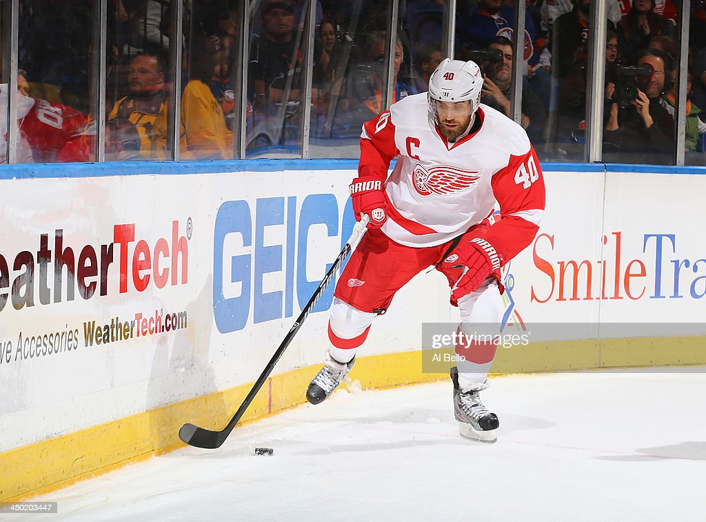 Henrik Zetterberg #40 of the Detroit Red Wings in action against the New York Islanders during their game at the Nassau Veterans Memorial Coliseum on November 16, 2013 in Uniondale, New York.