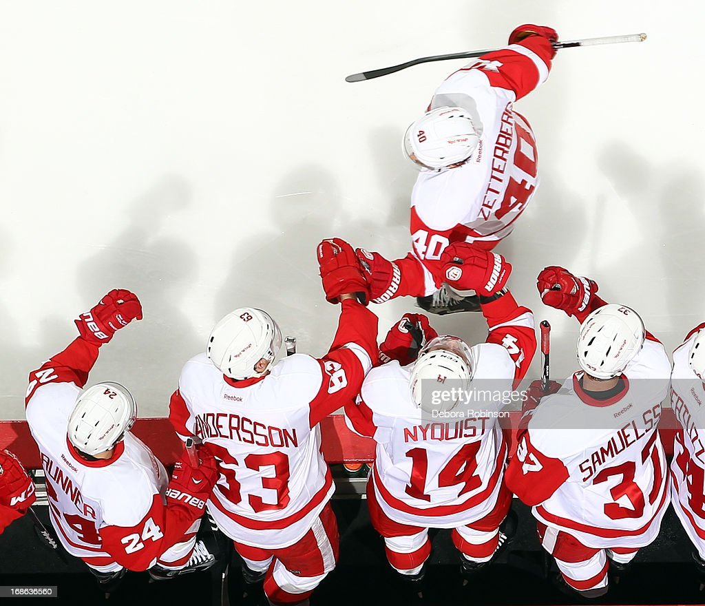 Henrik Zetterberg #40 of the Detroit Red Wings is congratulated by teammates after his first period goal against the Anaheim Ducks in Game Seven of the Western Conference Quarterfinals during the 2013 NHL Stanley Cup Playoffs at Honda Center on May 12, 2013 in Anaheim, California.