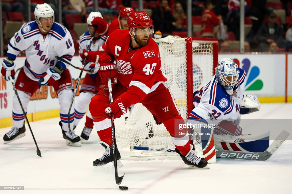Henrik Zetterberg #40 of the Detroit Red Wings looks to make a play in front of Antti Raanta #32 of the New York Rangers during the third period at Joe Louis Arena on March 12, 2017 in Detroit, Michigan. New York won the game 4-1.