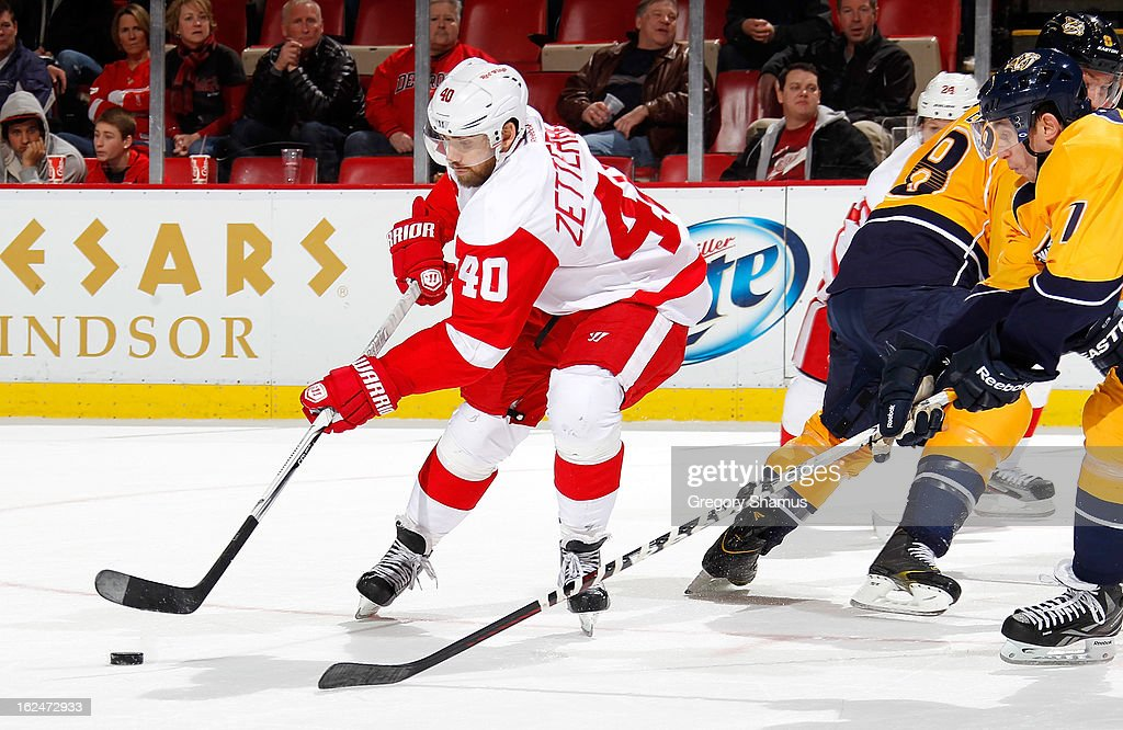 <a gi-track='captionPersonalityLinkClicked' href=/galleries/search?phrase=Henrik+Zetterberg&family=editorial&specificpeople=201520 ng-click='$event.stopPropagation()'>Henrik Zetterberg</a> #40 of the Detroit Red Wings looks to make a third period back hand shot around <a gi-track='captionPersonalityLinkClicked' href=/galleries/search?phrase=Jonathon+Blum&family=editorial&specificpeople=4306183 ng-click='$event.stopPropagation()'>Jonathon Blum</a> #7 of the Nashville Predators at Joe Louis Arena on February 23, 2013 in Detroit, Michigan. Detroit won the game 4-0.