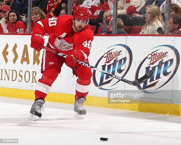 Henrik Zetterberg of the Detroit Red Wings makes a pass during an NHL game against the Minnesota Wild at Joe Louis Arena on March 11 2010 in Detroit...