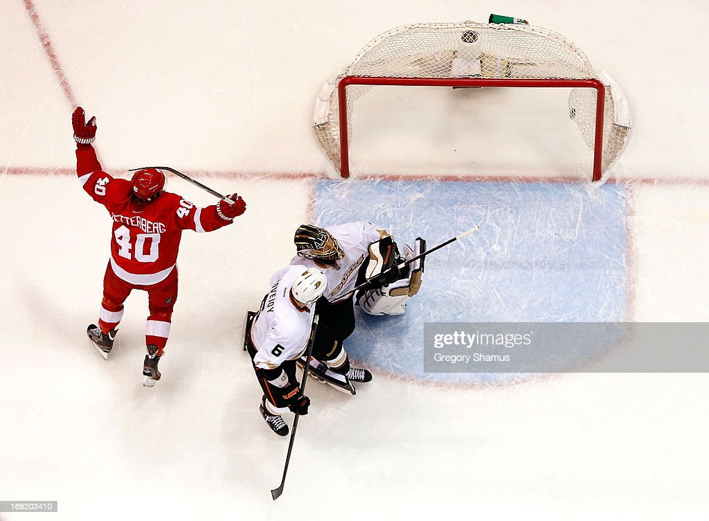 <a gi-track='captionPersonalityLinkClicked' href=/galleries/search?phrase=Henrik+Zetterberg&family=editorial&specificpeople=201520 ng-click='$event.stopPropagation()'>Henrik Zetterberg</a> #40 of the Detroit Red Wings reacts to a third period goal by teammate Pavel Datsyuk #13 next to <a gi-track='captionPersonalityLinkClicked' href=/galleries/search?phrase=Jonas+Hiller&family=editorial&specificpeople=743364 ng-click='$event.stopPropagation()'>Jonas Hiller</a> #1 and <a gi-track='captionPersonalityLinkClicked' href=/galleries/search?phrase=Ben+Lovejoy&family=editorial&specificpeople=4509565 ng-click='$event.stopPropagation()'>Ben Lovejoy</a> #6 of the Anaheim Ducks in Game Four of the Western Conference Quarterfinals during the 2013 NHL Stanley Cup Playoffs at Joe Louis Arena on May 6, 2013 in Detroit, Michigan. Detroit won the game 3-2 in Overtime to tie the series 2-2.