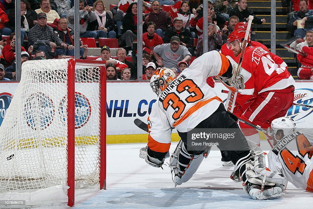 Henrik Zetterberg #40 of the Detroit Red Wings scores a goal on Brian Boucher #33 of the Philadelphia Flyers during an NHL game at Joe Louis Arena on January 2, 2011 in Detroit, Michigan. Flyers beat Wings 3-2