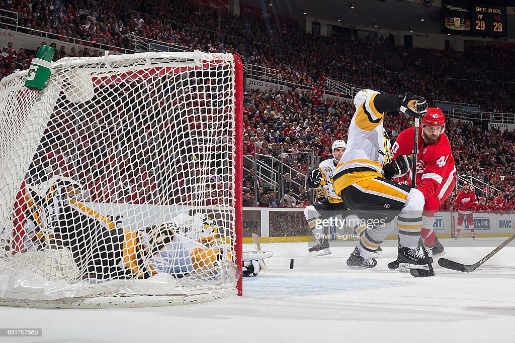 Henrik Zetterberg #40 of the Detroit Red Wings scores a third period goal past the defense of Sidney Crosby #87 and teammate goaltender Marc-Andre Fleury #29 of the Pittsburgh Penguins during an NHL game at Joe Louis Arena on January 14, 2017 in Detroit, Michigan. The Wings defeated the Penguins 6-3.