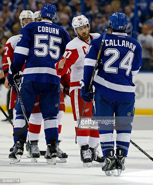 Henrik Zetterberg of the Detroit Red Wings shakes hands with Ryan Callahan of the Tampa Bay Lightning after Game Five of the Eastern Conference First...