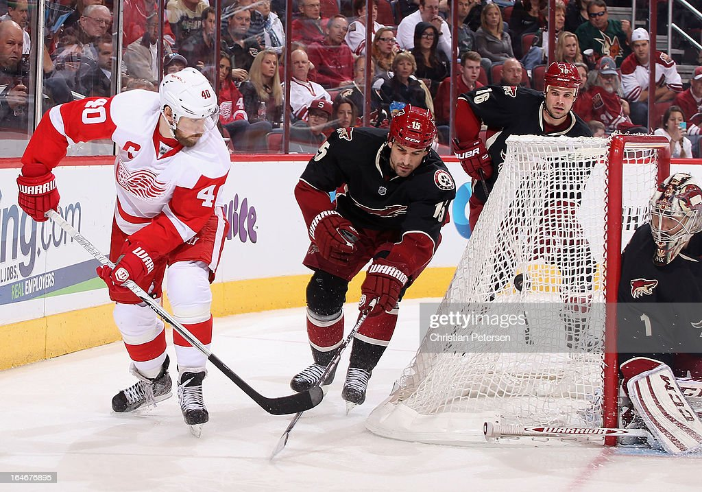 <a gi-track='captionPersonalityLinkClicked' href=/galleries/search?phrase=Henrik+Zetterberg&family=editorial&specificpeople=201520 ng-click='$event.stopPropagation()'>Henrik Zetterberg</a> #40 of the Detroit Red Wings shoots the puck into the back of the net as <a gi-track='captionPersonalityLinkClicked' href=/galleries/search?phrase=Boyd+Gordon&family=editorial&specificpeople=209395 ng-click='$event.stopPropagation()'>Boyd Gordon</a> #15 of the Phoenix Coyotes defends during the NHL game at Jobing.com Arena on March 25, 2013 in Glendale, Arizona. The Red Wings defeated the Coyotes 3-2.