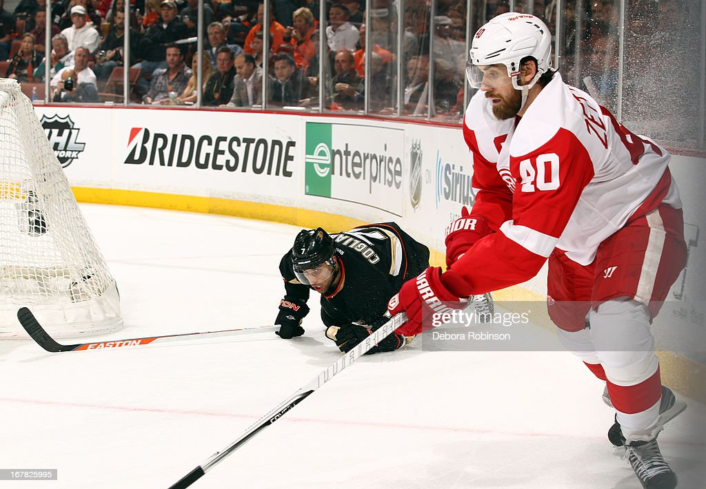 Henrik Zetterberg #40 of the Detroit Red Wings skates by a fallen Andrew Cogliano #7 of the Anaheim Ducks in Game One of the Western Conference Quarterfinals during the 2013 NHL Stanley Cup Playoffs at Honda Center on April 30, 2013 in Anaheim, California.