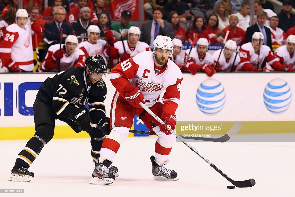 <a gi-track='captionPersonalityLinkClicked' href=/galleries/search?phrase=Henrik+Zetterberg&family=editorial&specificpeople=201520 ng-click='$event.stopPropagation()'>Henrik Zetterberg</a> #40 of the Detroit Red Wings skates the puck against <a gi-track='captionPersonalityLinkClicked' href=/galleries/search?phrase=Erik+Cole&family=editorial&specificpeople=204754 ng-click='$event.stopPropagation()'>Erik Cole</a> #72 of the Dallas Stars at American Airlines Center on April 27, 2013 in Dallas, Texas.