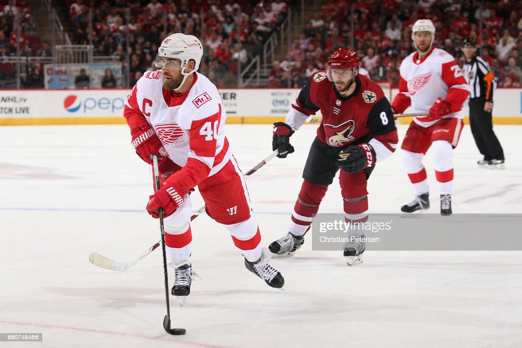 Henrik Zetterberg #40 of the Detroit Red Wings skates with the puck ahead of Tobias Rieder #8 of the Arizona Coyotes during the second period of the NHL game at Gila River Arena on October 12, 2017 in Glendale, Arizona. The Red Wings defeated the Coyotes 4-2.