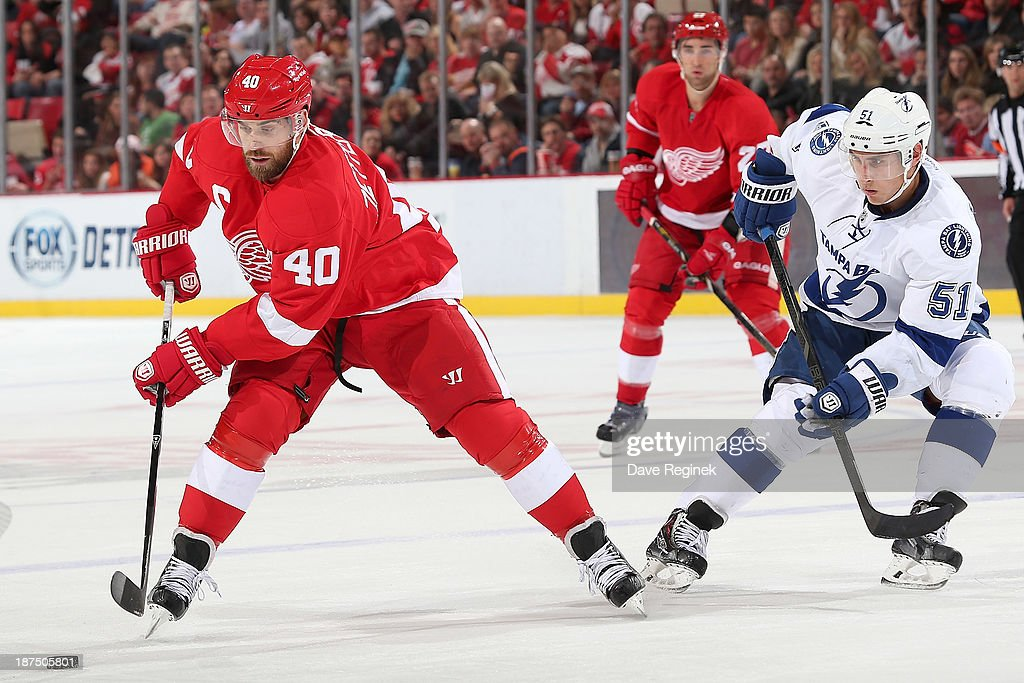 <a gi-track='captionPersonalityLinkClicked' href=/galleries/search?phrase=Henrik+Zetterberg&family=editorial&specificpeople=201520 ng-click='$event.stopPropagation()'>Henrik Zetterberg</a> #40 of the Detroit Red Wings skates with the puck as <a gi-track='captionPersonalityLinkClicked' href=/galleries/search?phrase=Valtteri+Filppula&family=editorial&specificpeople=2234404 ng-click='$event.stopPropagation()'>Valtteri Filppula</a> #51 of the Tampa Bay Lightning defends during an NHL game at Joe Louis Arena on November 9, 2013 in Detroit, Michigan.