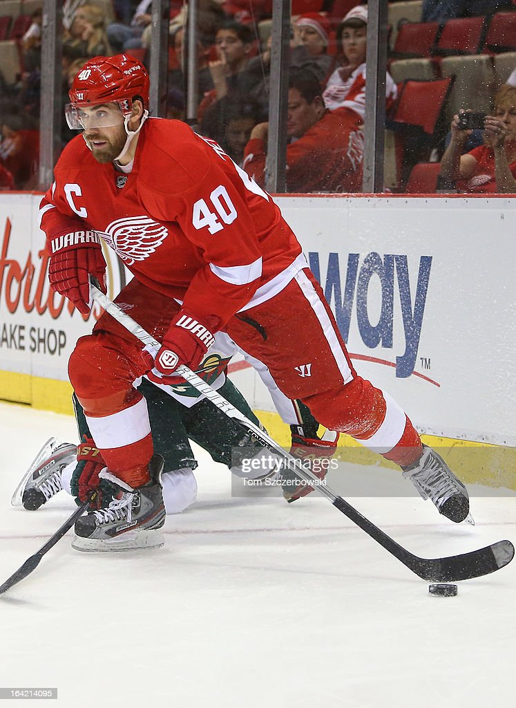Henrik Zetterberg #40 of the Detroit Red Wings skates with the puck from behind his net during NHL action against the Minnesota Wild at Joe Louis Arena on March 20, 2013 in Detroit, Michigan.