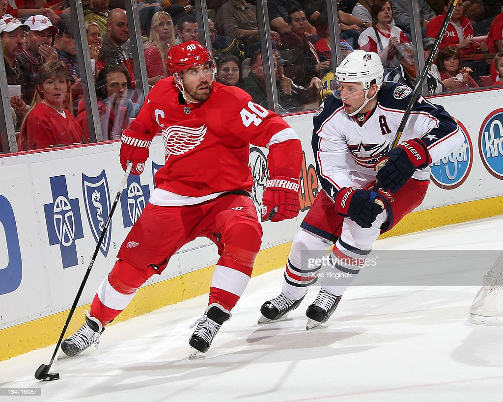 <a gi-track='captionPersonalityLinkClicked' href=/galleries/search?phrase=Henrik+Zetterberg&family=editorial&specificpeople=201520 ng-click='$event.stopPropagation()'>Henrik Zetterberg</a> #40 of the Detroit Red Wings skates with the puck behind the net as Jack Johnson #7 of the Columbus Blue Jackets gives chase during a NHL game at Joe Louis Arena on October 15, 2013 in Detroit, Michigan.