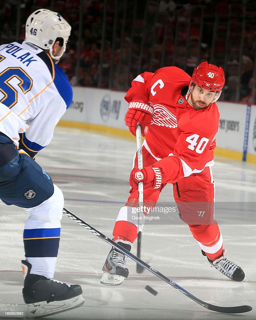 <a gi-track='captionPersonalityLinkClicked' href=/galleries/search?phrase=Henrik+Zetterberg&family=editorial&specificpeople=201520 ng-click='$event.stopPropagation()'>Henrik Zetterberg</a> #40 of the Detroit Red Wings takes a slap shot as defender <a gi-track='captionPersonalityLinkClicked' href=/galleries/search?phrase=Roman+Polak&family=editorial&specificpeople=2109482 ng-click='$event.stopPropagation()'>Roman Polak</a> #46 of the St. Louis Blues steps in the way during a NHL game at Joe Louis Arena on April 7, 2013 in Detroit, Michigan. St. Louis defeated Detroit 1-0