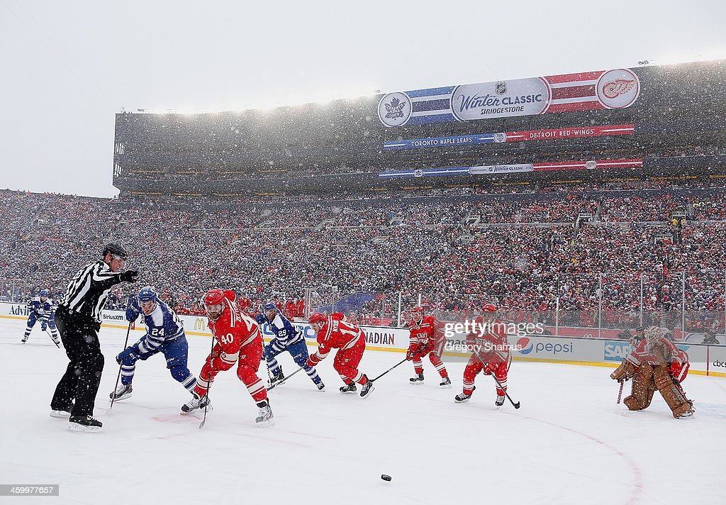 <a gi-track='captionPersonalityLinkClicked' href=/galleries/search?phrase=Henrik+Zetterberg&family=editorial&specificpeople=201520 ng-click='$event.stopPropagation()'>Henrik Zetterberg</a> #40 of the Detroit Red Wings wins a face off against Peter Holland #24 of the Toronto Maple Leafs during the first period of the 2014 Bridgestone NHL Winter Classic at Michigan Stadium on January 1, 2014 in Ann Arbor, Michigan.