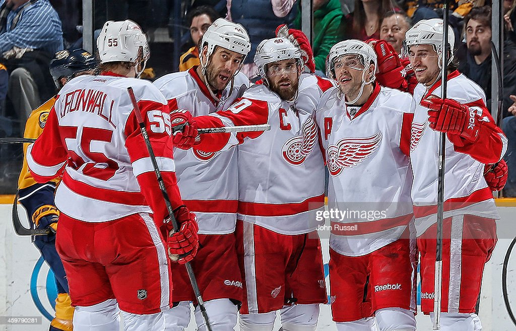 <a gi-track='captionPersonalityLinkClicked' href=/galleries/search?phrase=Henrik+Zetterberg&family=editorial&specificpeople=201520 ng-click='$event.stopPropagation()'>Henrik Zetterberg</a> #40, <a gi-track='captionPersonalityLinkClicked' href=/galleries/search?phrase=Pavel+Datsyuk&family=editorial&specificpeople=202893 ng-click='$event.stopPropagation()'>Pavel Datsyuk</a> #13 and <a gi-track='captionPersonalityLinkClicked' href=/galleries/search?phrase=Niklas+Kronwall&family=editorial&specificpeople=220826 ng-click='$event.stopPropagation()'>Niklas Kronwall</a> #55 of the Detroit Red Wings celebrate a goal against the Nashville Predators at Bridgestone Arena on December 30, 2013 in Nashville, Tennessee.