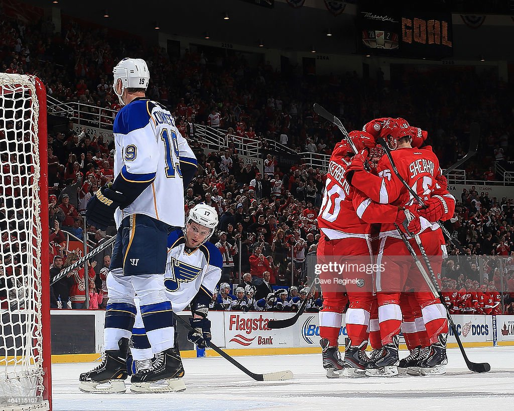 <a gi-track='captionPersonalityLinkClicked' href=/galleries/search?phrase=Henrik+Zetterberg&family=editorial&specificpeople=201520 ng-click='$event.stopPropagation()'>Henrik Zetterberg</a> #40, <a gi-track='captionPersonalityLinkClicked' href=/galleries/search?phrase=Tomas+Tatar&family=editorial&specificpeople=5652303 ng-click='$event.stopPropagation()'>Tomas Tatar</a> #21, <a gi-track='captionPersonalityLinkClicked' href=/galleries/search?phrase=Riley+Sheahan&family=editorial&specificpeople=7029365 ng-click='$event.stopPropagation()'>Riley Sheahan</a> #15 and <a gi-track='captionPersonalityLinkClicked' href=/galleries/search?phrase=Niklas+Kronwall&family=editorial&specificpeople=220826 ng-click='$event.stopPropagation()'>Niklas Kronwall</a> #55 of the Detroit Red Wings congratulate teammate <a gi-track='captionPersonalityLinkClicked' href=/galleries/search?phrase=Gustav+Nyquist&family=editorial&specificpeople=5491209 ng-click='$event.stopPropagation()'>Gustav Nyquist</a> #14 after scoring a goal as <a gi-track='captionPersonalityLinkClicked' href=/galleries/search?phrase=Jay+Bouwmeester&family=editorial&specificpeople=201875 ng-click='$event.stopPropagation()'>Jay Bouwmeester</a> #19 and <a gi-track='captionPersonalityLinkClicked' href=/galleries/search?phrase=Vladimir+Sobotka&family=editorial&specificpeople=716736 ng-click='$event.stopPropagation()'>Vladimir Sobotka</a> #17 of the St. Louis Blues can only watch during an NHL game on January 20, 2014 at Joe Louis Arena in Detroit, Michigan.