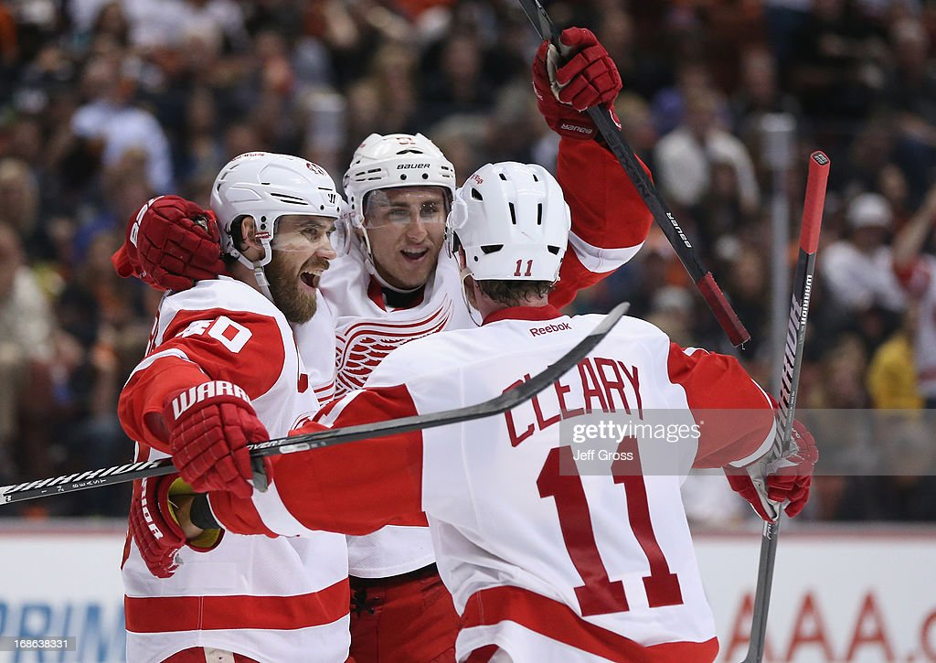 Henrik Zetterberg #40, Valtteri Filppula #51 and Daniel Cleary #11 of the Detroit Red Wings celebrate Filppula's goal in the second period against the Anaheim Ducks in Game Seven of the Western Conference Quarterfinals during the 2013 NHL Stanley Cup Playoffs at Honda Center on May 12, 2013 in Anaheim, California.