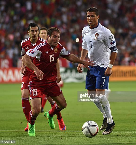 Henrikh Mkhitarya of Armenia and Hrayr Mkoyan vie with Cristiano Ronaldo of Portugal during the UEFA Euro 2016 qualifying match between Armenia and...