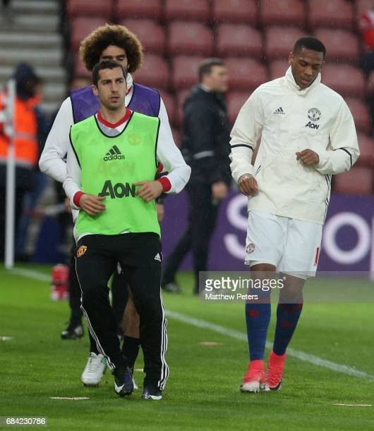 Henrikh Mkhitaryan and Anthony Martial of Manchester United warm up ahead of the Premier League match between Southampton and Manchester United at St...