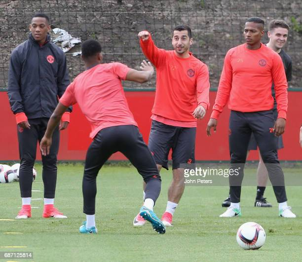 Henrikh Mkhitaryan and Antonio Valencia of Manchester United in action during a first team training session ahead of the UEFA Europa League Final at...